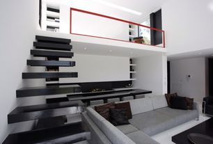 Modern Living Room with Loft, Adelaide sectional sofa, Concrete floors, High ceiling, can lights, Paint