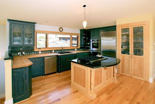 Traditional Kitchen with Large Ceramic Tile, Built In Refrigerator, Drop-in sink, U-shaped, full backsplash, Casement