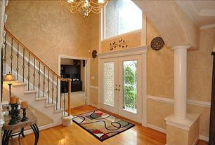 Traditional Entryway with Chandelier, interior wallpaper, Hardwood floors, High ceiling, Chair rail, Columns, French doors