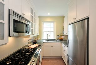 Traditional Kitchen with Soapstone counters, Built In Refrigerator, Standard height, Flat panel cabinets, Casement, U-shaped