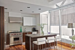 Contemporary Kitchen with Flush, Simple granite counters, Undermount sink, Calligaris even leather bar stool, Ceramic Tile