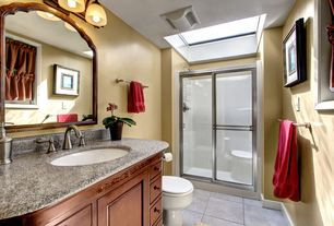 Traditional 3/4 Bathroom with Skylight, picture window, framed showerdoor, stone tile floors, Simple granite counters, Flush
