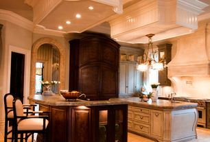 Traditional Kitchen with Kitchen island, Glass panel, High ceiling, U-shaped, Undermount sink, Limestone counters, Limestone