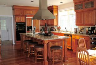 Traditional Kitchen with Breakfast bar, Simple granite counters, L-shaped, Raised panel, High ceiling, Glass panel door