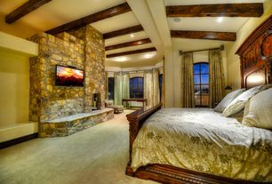 Rustic Master Bedroom with Standard height, can lights, Arched window, Casement, Exposed beam, Carpet