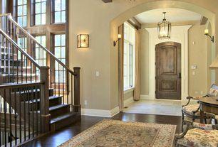 Mediterranean Entryway with sandstone floors, Standard height, Pendant light, specialty door