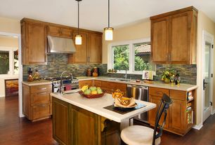 Craftsman Kitchen with Casement, full backsplash, Pendant light, dishwasher, Kitchen island, Flat panel cabinets, gas range