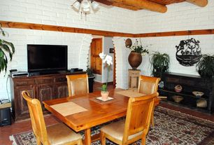 Rustic Dining Room with Exposed beam, interior brick, Ceiling fan, Brick floors