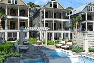 Tropical Swimming Pool with exterior concrete tile floors, Deck Railing, Pathway, Casement, French doors, Trellis