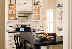 Traditional Kitchen with Breakfast bar, double-hung window, Chandelier, Glass panel, Wall Hood, Raised panel, Corian counters