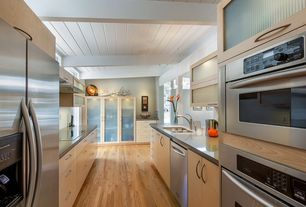 Contemporary Kitchen with wall oven, Wall Hood, built-in microwave, Standard height, Galley, Glass panel, electric cooktop