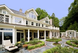 Traditional Patio with Pathway, Outdoor kitchen, exterior stone floors, Trellis, Transom window