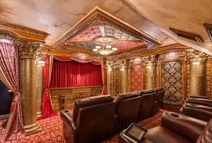 Traditional Home Theater with Wall sconce, Columns, Chandelier, Carpet