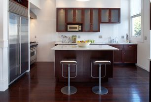 Contemporary Kitchen with Flush, Galley, Glass panel, Breakfast bar, Kitchen island, Undermount sink, Flat panel cabinets