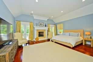 Contemporary Master Bedroom with French doors, Hardwood floors, Cement fireplace