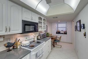 Traditional Kitchen with Simple granite counters, Breakfast nook, Glass panel, Raised panel, Stone Tile, L-shaped, Flush