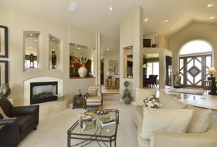 Contemporary Front Door with stone fireplace, Columns, Curved sofa, Carpet, Vaulted ceiling, Arched window, Paint, can lights