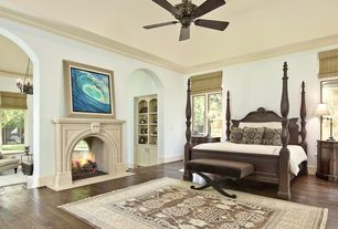 Traditional Master Bedroom with Cement fireplace, Ceiling fan, Crown molding, Hardwood floors