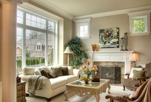 Traditional Living Room with Wainscotting, Carpet, Built-in bookshelf, Columns, Cement fireplace