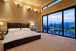 Contemporary Master Bedroom with picture window, Wall sconce, Balcony, Inset cabinets, Carpet, Master bathroom, High ceiling