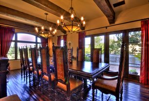Eclectic Dining Room with can lights, High ceiling, Exposed beam, picture window, Casement, French doors, Chandelier