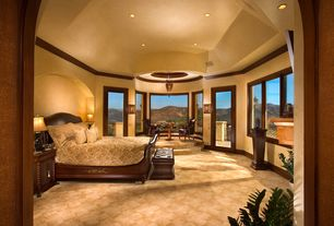 Traditional Master Bedroom with can lights, Carpet, Standard height, French doors, Pendant light, Crown molding, Wall sconce
