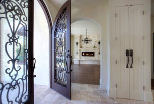 Mediterranean Entryway with Hardwood floors, Arizona Tile Salem Grey Tumbled Lyon Pattern, Arched doors, French doors