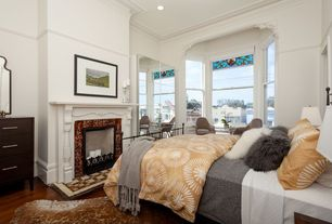 Master Bedroom with Built-in bookshelf, Crown molding, Columns, Hardwood floors, stone fireplace, High ceiling