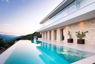 Contemporary Swimming Pool with Deck Railing, exterior tile floors, Other Pool Type, sliding glass door