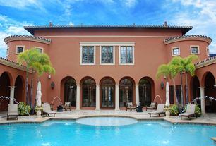 Mediterranean Swimming Pool with French doors, exterior stone floors, Fountain, Arched window, Transom window