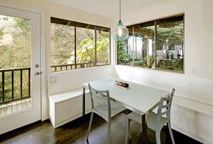 Contemporary Dining Room with French doors, Pendant light, Balcony, Hardwood floors
