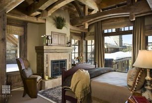 Country Guest Bedroom with Built in storage, Exposed beam, Built-in bookshelf, Carpet, High ceiling, Natural wood paneling