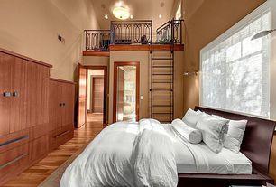 Modern Master Bedroom with Copeland furniture- catalina platform bed, Laminate floors, six panel door, Casement, Paint, Loft