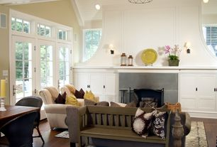 Traditional Living Room with Ballard Designs Eaton Club Chair, Cement fireplace, French doors, Wall sconce, Transom window