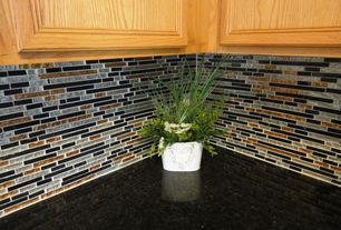 Modern Kitchen with Random sized mesh mounted glass and natural stone mosaic tile, Quartz countertop