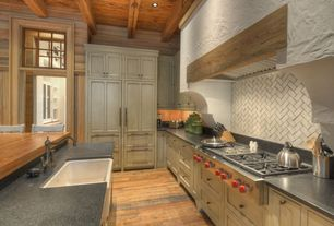 Rustic Kitchen with L-shaped, Simple granite counters, Breakfast bar, MS International Cambrian Black Granite, Custom hood