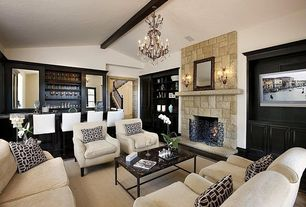 Craftsman Living Room with Hardwood floors, stone fireplace, Built-in bookshelf, Exposed beam, Chandelier, Wall sconce