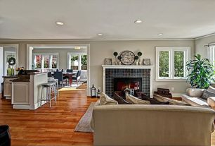 Traditional Living Room with Hardwood floors, Ceramic tile fireplace, Crown molding, Open concept