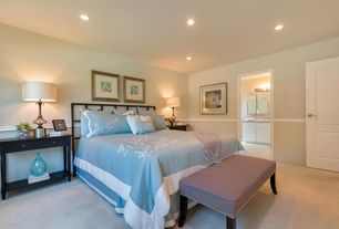 Traditional Master Bedroom with specialty door, Standard height, can lights, Chair rail, Carpet