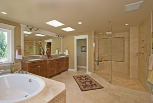 Craftsman Master Bathroom with Arizona Tile Jura Beige Limestone, Frameless, Complex granite counters, Double sink, Skylight