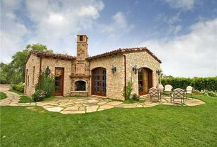 Eclectic Patio with Outdoor fireplace, Fence, French doors, Natural stone exterior