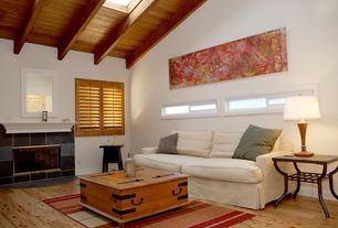 Traditional Living Room with Casement, Exposed beam, Hardwood floors, Fireplace, High ceiling, Skylight, insert fireplace