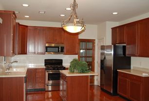Craftsman Kitchen with U-shaped, Large Ceramic Tile, Glass panel door, Pendant light, Flat panel cabinets, Laminate floors