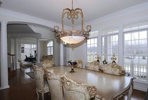 Traditional Dining Room with High ceiling, Transom window, double-hung window, flush light, Columns, Wainscotting