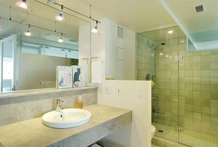 Modern 3/4 Bathroom with can lights, Handheld showerhead, Concrete counters, Drop-in sink, Standard height, framed showerdoor