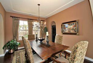 Mediterranean Dining Room with Casement, Chandelier, Standard height, specialty door, Paint, Hardwood floors