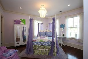 Modern Kids Bedroom with Standard height, can lights, Crown molding, flush light, double-hung window, Hardwood floors