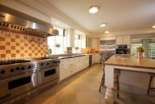 Traditional Kitchen with Vinyl floors, Wood counters, L-shaped, French doors, Kitchen island, Raised panel, Flush
