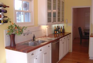 Traditional Kitchen with Cinnamon maple solid hardwood flooring, Glass Tile, Glass panel, Wood countertop, One-wall
