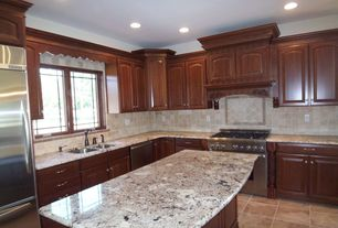 Traditional Kitchen with Raised panel, Complex granite counters, Undermount sink, High ceiling, Kitchen island, Custom hood